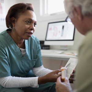 Older adult speaking with their healthcare provider